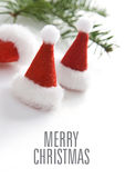 Christmas greeting card with small santa hats. One big santa hat Royalty Free Stock Photo