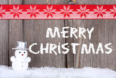 Christmas Greeting Card with a small Snowman Royalty Free Stock Photography