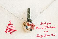 Christmas greeting card with snowman clothespin Stock Photography