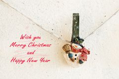 Christmas greeting card with snowman clothespin Royalty Free Stock Photography