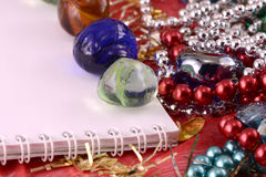 Christmas greeting card with stones, pearls and paper note Royalty Free Stock Photo