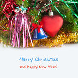 Christmas greeting card template with fir tree, red toy heart and blue bell (with easy removable sample text) Royalty Free Stock Photo