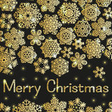 Christmas greeting card with text Merry Christmas and snowflakes. Golden snowflakes on black  background with lights Stock Image