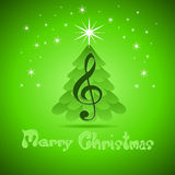 Christmas greeting Card with treble clef Royalty Free Stock Photo