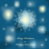 Christmas greeting card. Vector Christmas card with ornamental snowflakes on a blue background Stock Photography