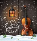 Christmas background with violin and old lantern royalty free stock photo