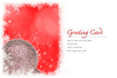 Christmas greeting card. White Christmas ball and red bokeh background with copy space and snowflakes border. easy to add your text Royalty Free Stock Image