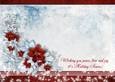 Christmas greeting card with the wishes and poinsettia. Gorgeous Christmas card with beautiful winter flowers and poinsettia with a copyspace on the background Royalty Free Stock Images