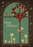 Christmas greeting card with wreatjh on window Stock Image