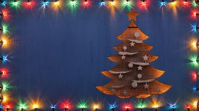 Christmas greeting card with xmas tree and decorative lights royalty free stock images