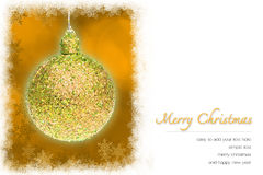 Christmas greeting card. Yellow Christmas ball and yellow bokeh background with copy space and snowflakes border. easy to add your text Stock Photos