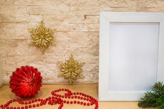 Christmas greeting cards, space for text. Golden and red decorations, fir tree branches. royalty free stock photo