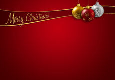 Christmas greeting. Colorful christmas balls hanging on a red background Stock Images