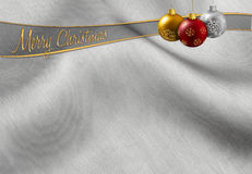 Christmas greeting. Colorful christmas balls hanging on a silvery background Stock Photo