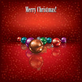 Christmas greeting with decorations on red Royalty Free Stock Photography