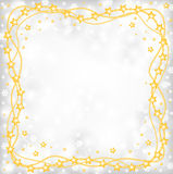 Christmas greeting frame of gold beads on blur gray background a Royalty Free Stock Photography