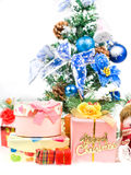 Christmas greeting gifts front of a christmas tree Stock Image