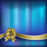 Christmas greeting gold bow with ribbon Royalty Free Stock Photo
