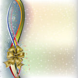 Christmas greeting gold bow with ribbons Royalty Free Stock Photography