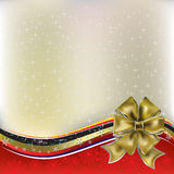 Christmas greeting gold bow with ribbons Stock Photo