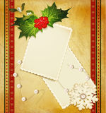 Christmas greeting with holly and cards Stock Images