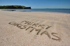 Christmas Greeting. Merry Christmas message on a beach stock image