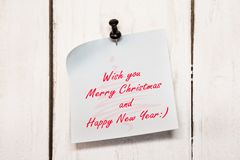 Christmas greeting note paper with pin Stock Images