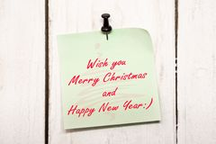 Christmas greeting note paper with pin Royalty Free Stock Photography