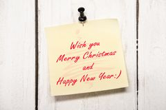 Christmas greeting note paper with pin Stock Image