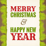 Christmas greeting on old paper with fir in background Stock Images