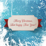 Christmas greeting paper Label and red Ribbon. Realistic Christmas greeting paper Label and red Ribbon on Snow and Ice Background. Vector Illustration Stock Photo