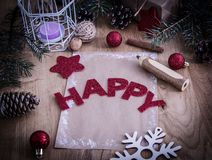 Christmas greeting ,a pencil,a postcard on wooden background. Holiday concept stock photography