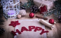 Christmas greeting ,a pencil,a postcard on wooden background. Holiday concept royalty free stock photography