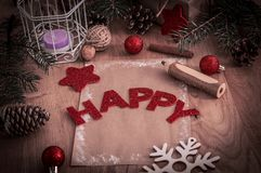 Christmas greeting ,a pencil,a postcard on wooden background. Holiday concept stock images