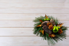 Christmas greeting with pine branches and golden cones Stock Photos