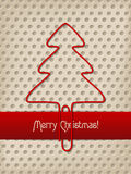 Christmas greeting with red ribbon and tree shaped paper clip Royalty Free Stock Images