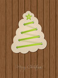 Christmas greeting with shoe lace tree and wooden background Stock Image