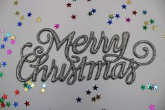 Christmas greeting in silver color stock images
