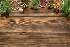 Christmas background, free space for text. Christmas greeting table background. Dried sicilian oranges, golden fir cones, spices, like anise and cinnamon sticks royalty free stock photos