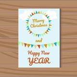 Christmas greeting vector card and happy new year with festive ribbons. Christmas greeting card and happy New Year with festive colorful ribbons on a blue Royalty Free Stock Image