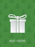 Christmas greeting with white giftbox. Christmas greeting card with white giftbox and green scribbled christmastree background Stock Photo