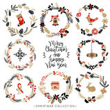 Christmas greeting wreaths with calligraphy. Hand drawn elements. Royalty Free Stock Image