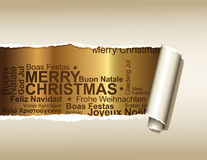Christmas greetings. Ripped paper displaying a golden background with christmas greetings in different languages Stock Image