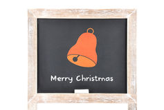 Christmas greetings with bell on blackboard Stock Images