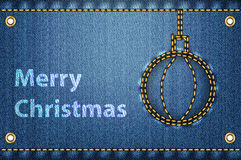 Christmas greetings on blue jeans background Stock Images