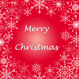 Christmas greetings card. Merry Christmas wishing card with snowflakes border and a bright red background Royalty Free Stock Photography