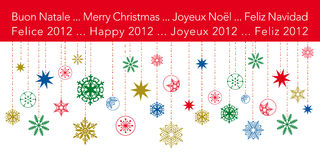 Christmas Greetings card with hanging snowflakes. With text in four different languages Stock Images