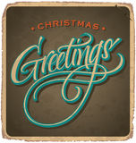 CHRISTMAS GREETINGS vintage card (vector). CHRISTMAS GREETINGS vintage card with hand lettering -- handmade calligraphy, and with grunge effect Royalty Free Stock Image