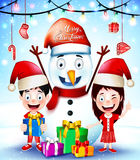 Christmas Greetings with Happy Kids and Snowman Wearing Santa Hat Royalty Free Stock Image