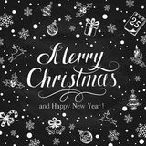 Christmas greetings with holiday decorations on black chalkboard Royalty Free Stock Image